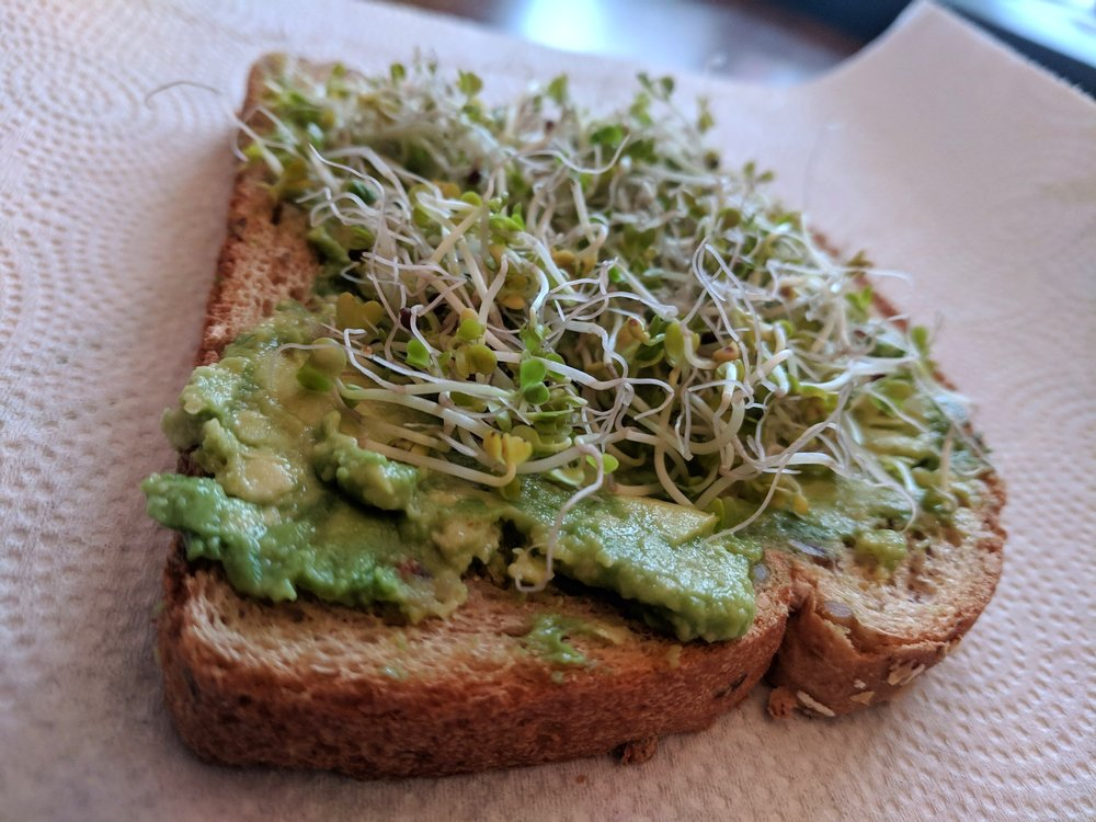 Avocado Toast - So basic. So delicious!Recipe:Whole grain toastMashed avocadoBroccoli sprouts