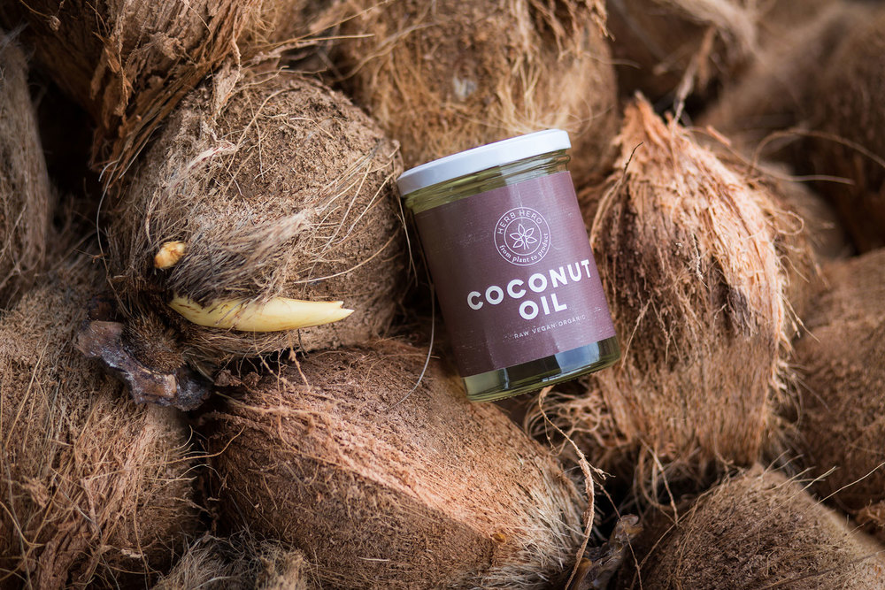 Herb Hero Coconut oil with pealed coconuts