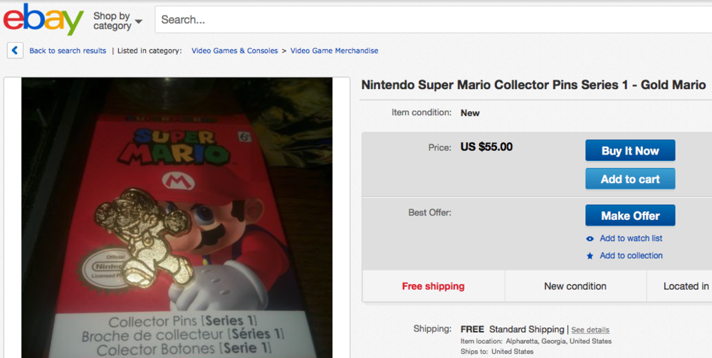A rare Gold Mario Pin on eBay.