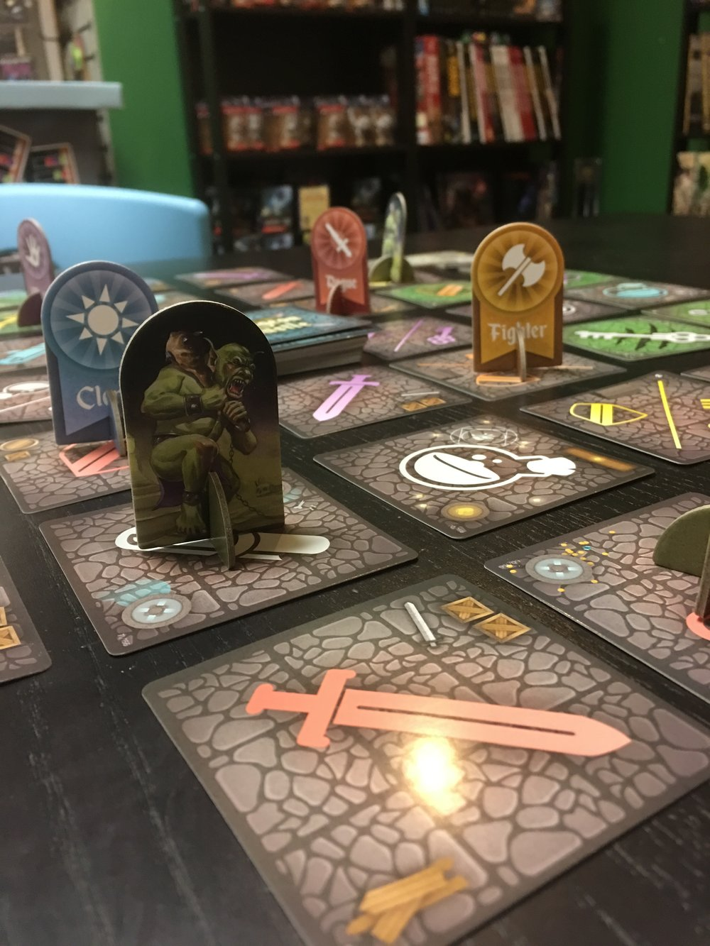 The fearsome monster is threatening the generic player tokens!