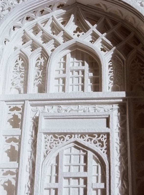 Christina Lihan makes incredibly intricate paper relief architectural models.  http://www.lihanstudio.com/index.php?section=13