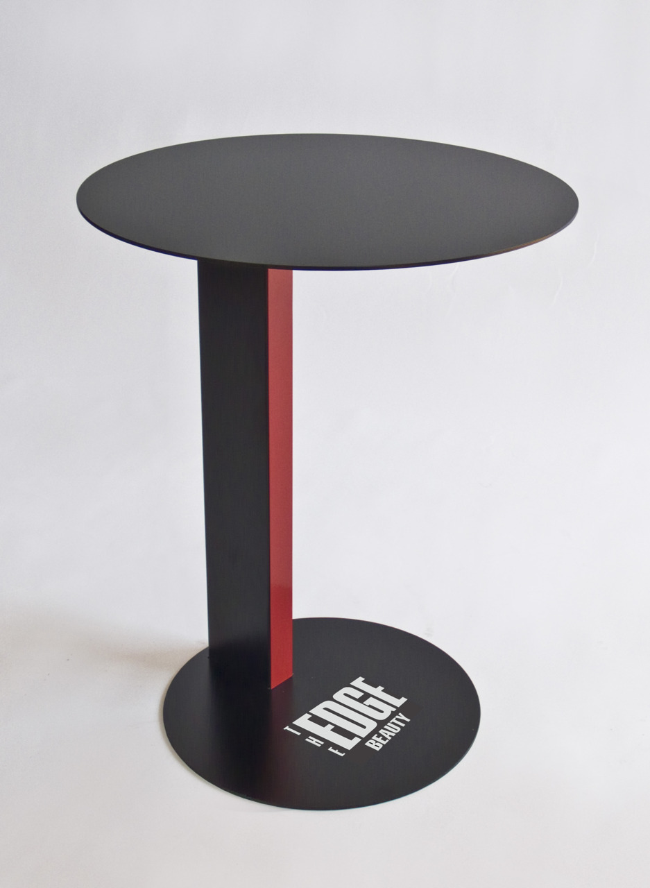 From OK Works, a companion table for a freestanding make-over station for The Edge Shop, at Dillard's.  Fabricated in steel with a powdercoated finish and a custom decal.    www.okworks.com