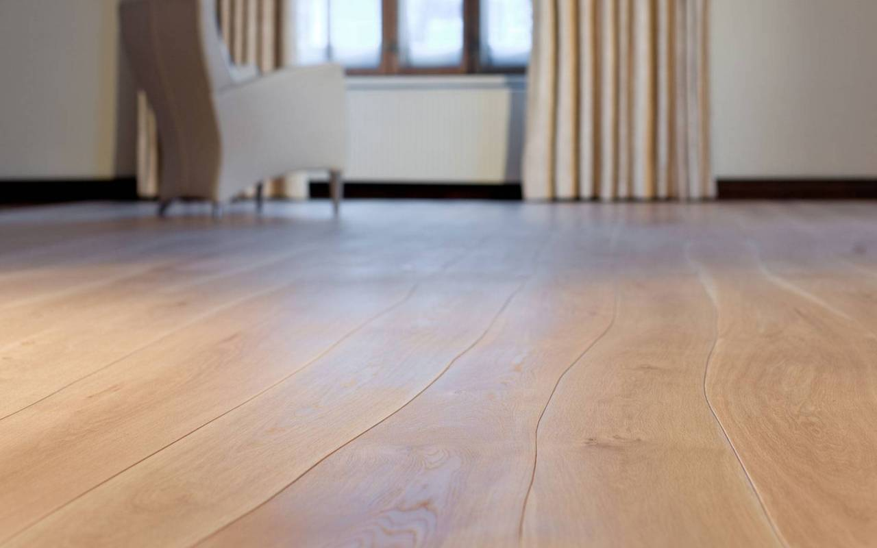 Hardwood flooring with naturally curved lengths that follow a tree's natural growth. See Bolefloor at http://www.bolefloor.com/en/