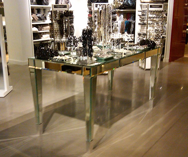 "From OK Works, a faceted, mirrored table for Express.   With aluminum ferrules, the table measures 72"" wide x 30"" deep x 34"" high.      www.okworks.com"