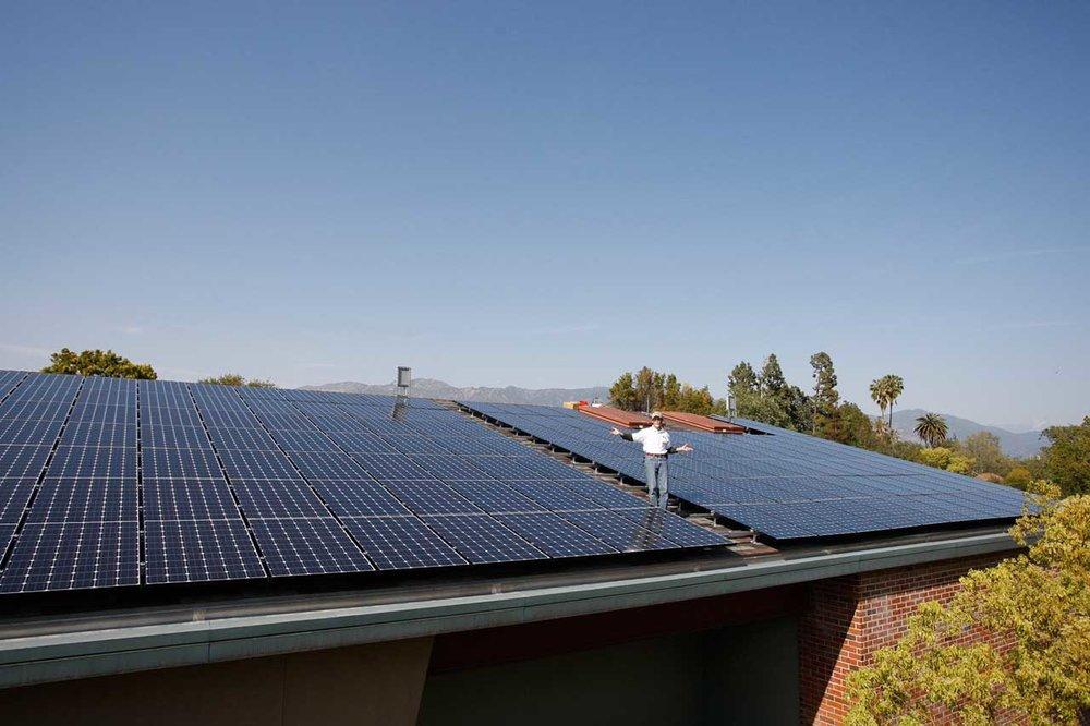 Jim Jenal (CEO, Founder, Run on Sun) on school roof - Photo, Run on Sun