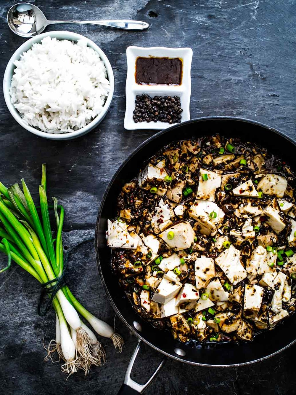 This Mapo Tofu recipe has two versions: one with easy to find ingredients, the other more traditional! And it's vegan! #chinese #rice #sichuan #spicy #vegetarian #mushrooms #plant #based
