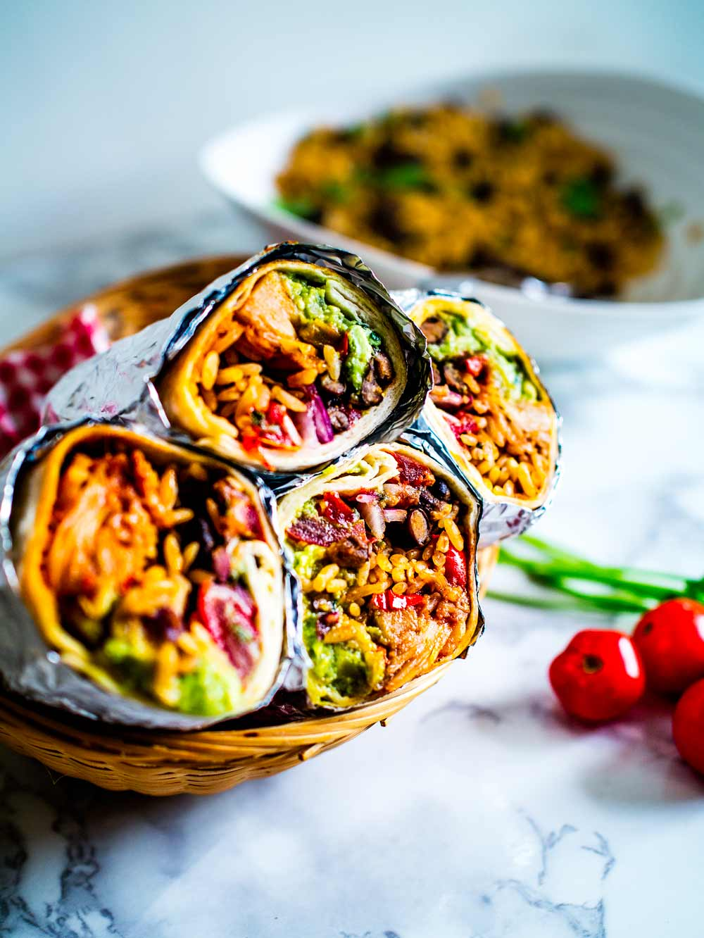 These epic vegan jackfruit burritos are filled with mexican rice, guacamole, refried black beans, pico de gallo and bbq jackfruit! Sumptuously satisfying!     #recipe #recipes #burrito #fajita #healthy #lunches #dinners #wrap #sauce #bean #freezer #filling #best #jackfruit #vegan #vegetarian #salsa