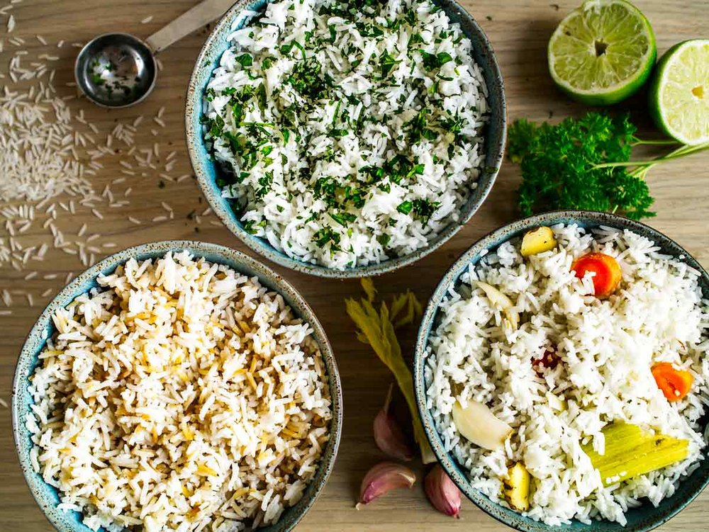 3 simple ways to liven up rice! Left: toast the rice prior to cooking + sesame oil & soy sauce. Middle: add herbs & lime juice. Right: cook in aromatics such as garlic and ginger! All 3 recipes in one post. Plus method for perfect, fluffy rice!  #rice #recipes #easy #herbs #lime #basmati  #simple #ways #how #to #cook #make #cilantro #lime #bowl #flavoured #vegetarian #vegan #savoury #vegetable #white #recipe