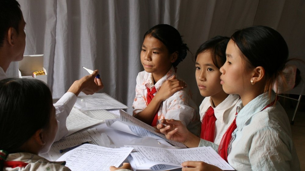 School girls at an HPV vaccination campaign event in Vietnam.