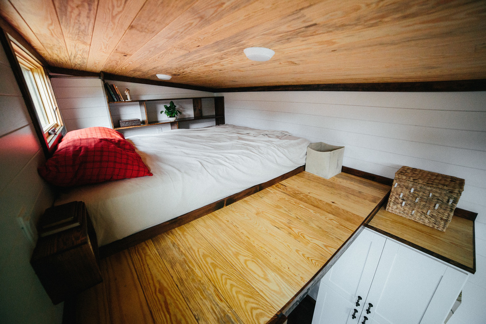 The Chimera by Wind River Tiny Homes. Master Loft. Built in nightside tables, welded rod handrail and clothing rail, built in cubbys.