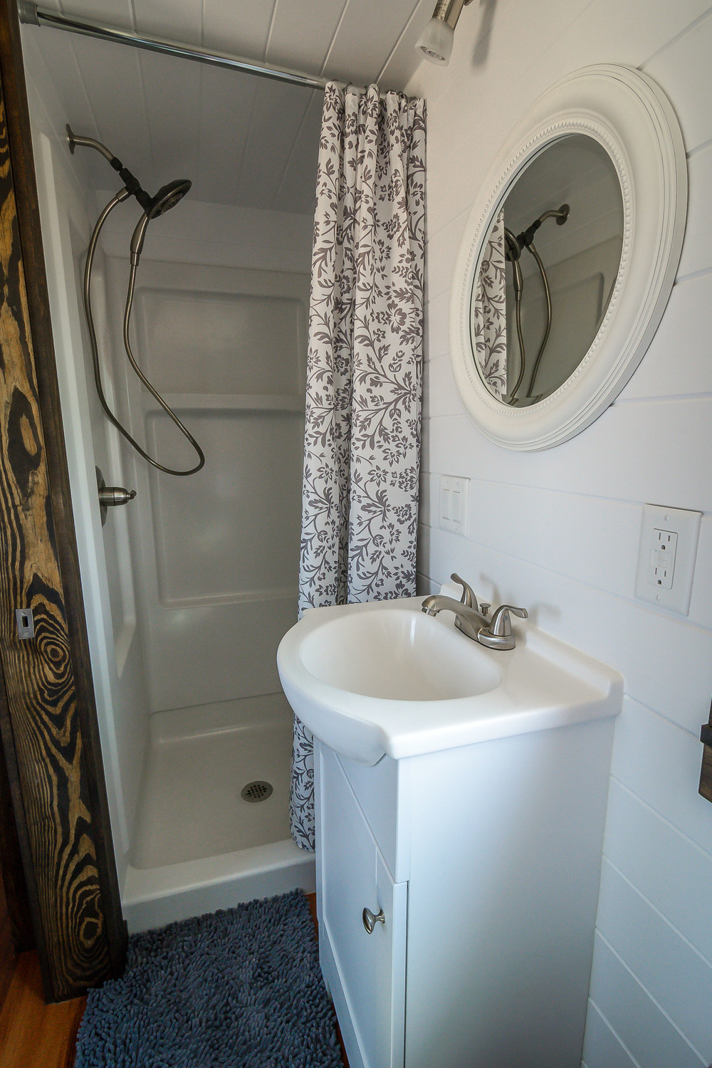 The Triton By Wind River Tiny Homes Bathroom With Vanity And Custom Built In Shelving
