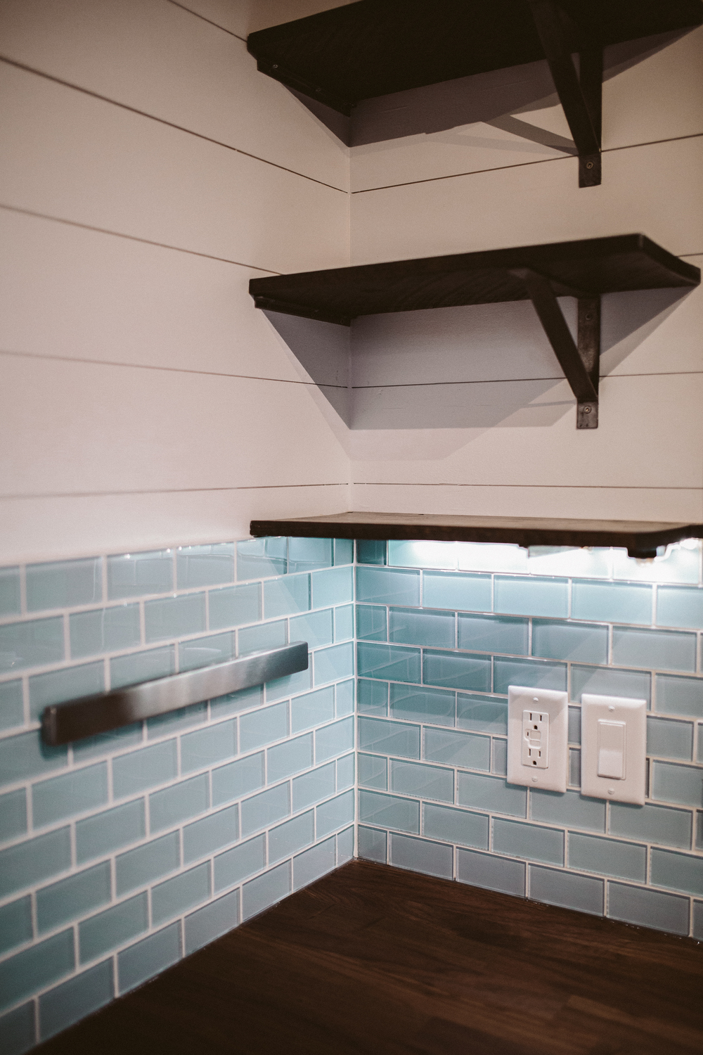 The Mayflower - Butcher block counters, custom welded open shelving, seaglass subway tile, and magnetic knife holder