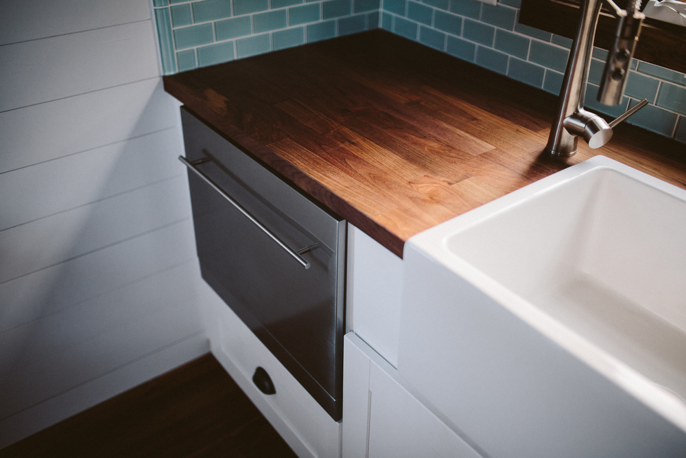 The Mayflower - Drawer dishwasher, farmhouse sink, butcher block counters, and seaglass subway tile