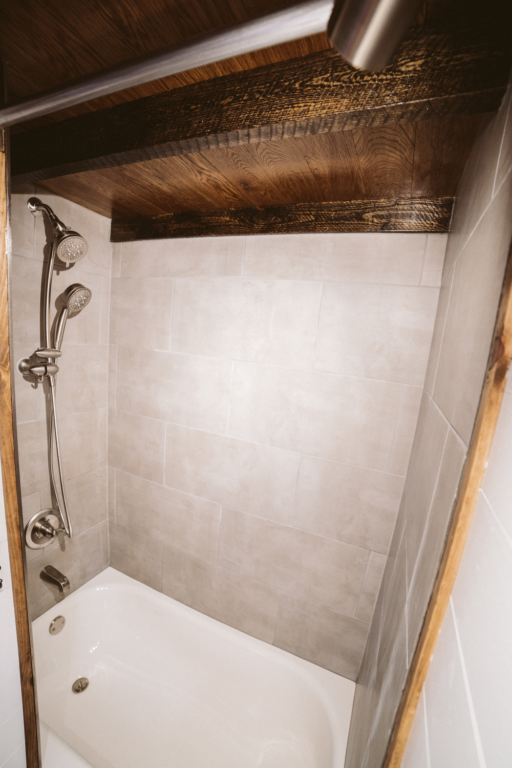 The Mayflower - Bathtub with grey tiled walls