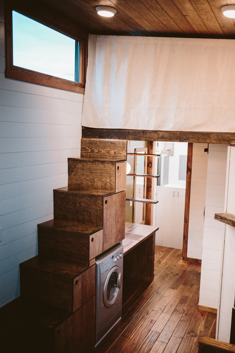 The Mayflower - Built in storage stairs up to master loft with privacy curtain pulled