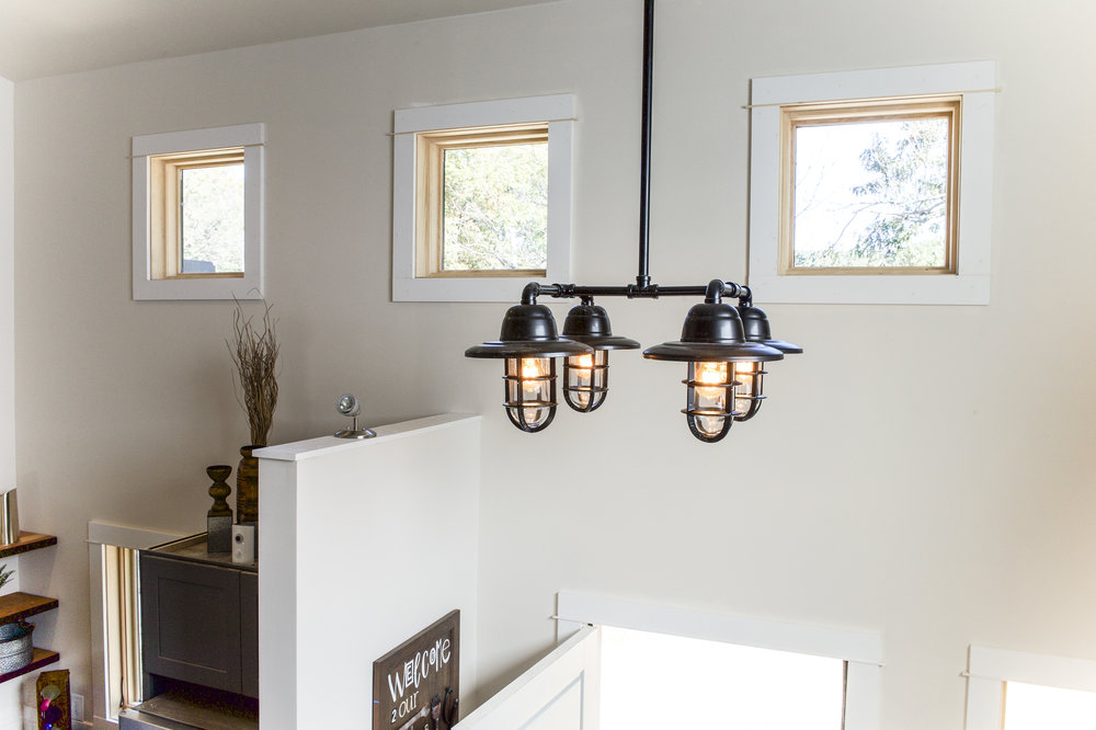 Urban Micro Home by Wind River Tiny Homes - steel pipe chandelier
