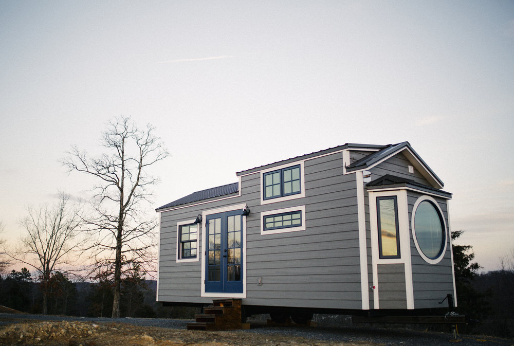 The Monocle by Wind River Tiny Homes - LP smartside, metal roof, aluminum clad windows, 10 foot wide design