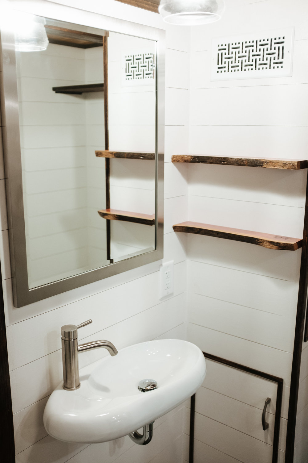 The Ironclad by Wind River Tiny Homes - floating sink, ship lap, cedar live edge shelves