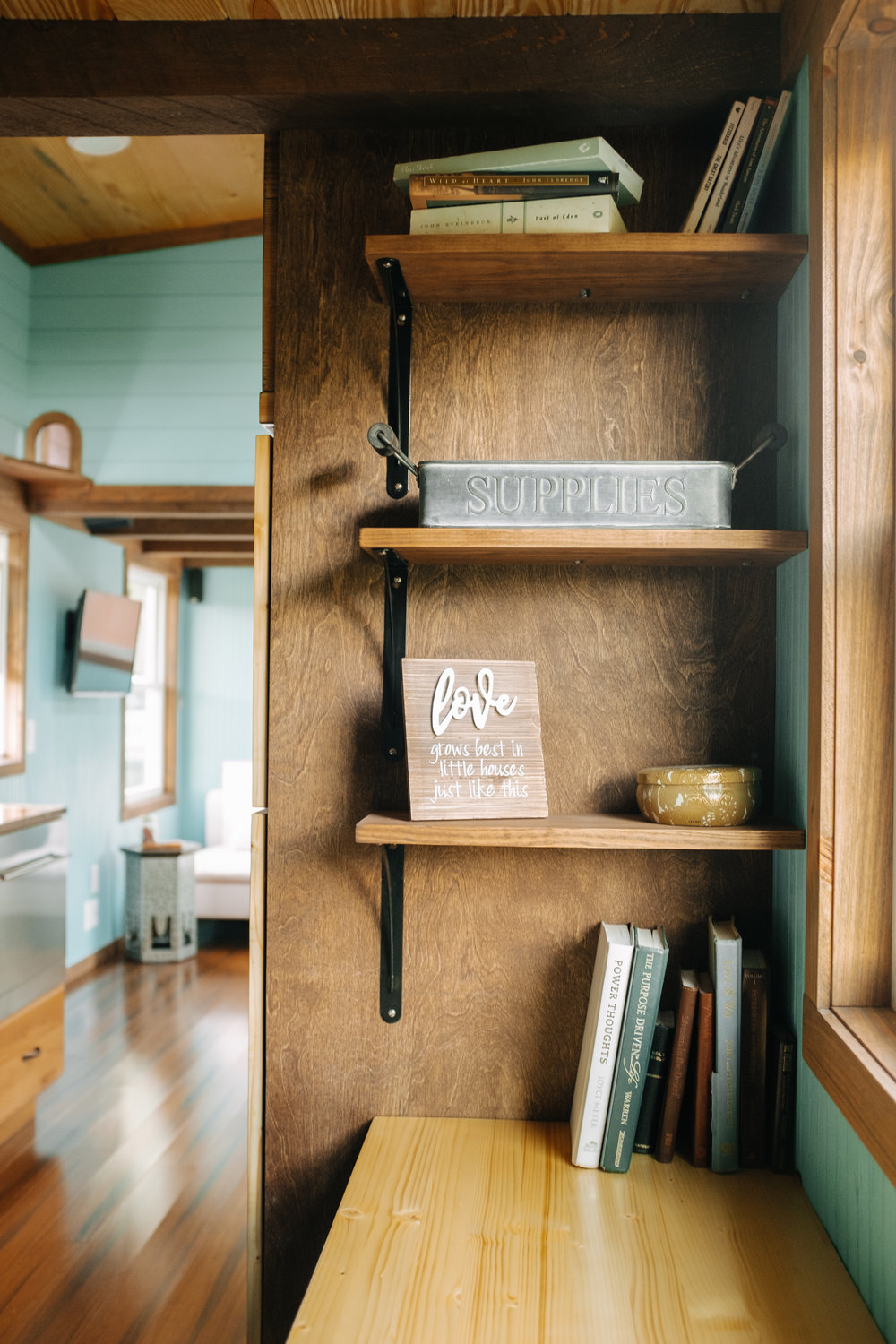 The Big Whimsy by Wind River Tiny Homes - built in desk space, open shelving, LED lighting