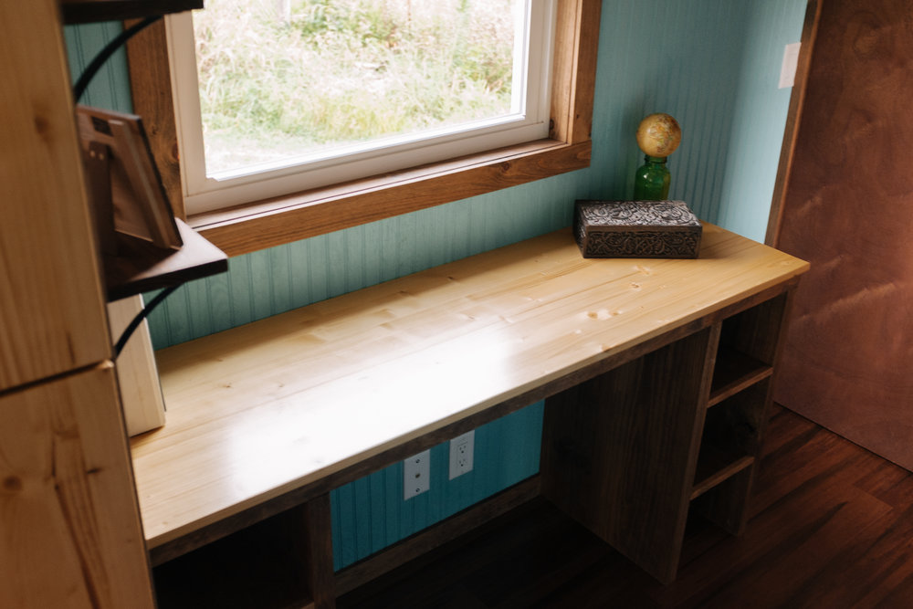 The Big Whimsy by Wind River Tiny Homes - built in desk space, open shelving