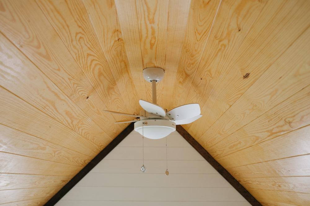 The Acadia by Wind River Tiny Homes - tiny house, ship lap, natural pine ceiling, tiny fan