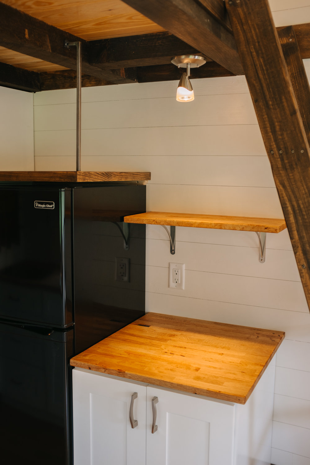 The Acadia by Wind River Tiny Homes - tiny house, ship lap, shaker cabinets, open shelving, loft ladder