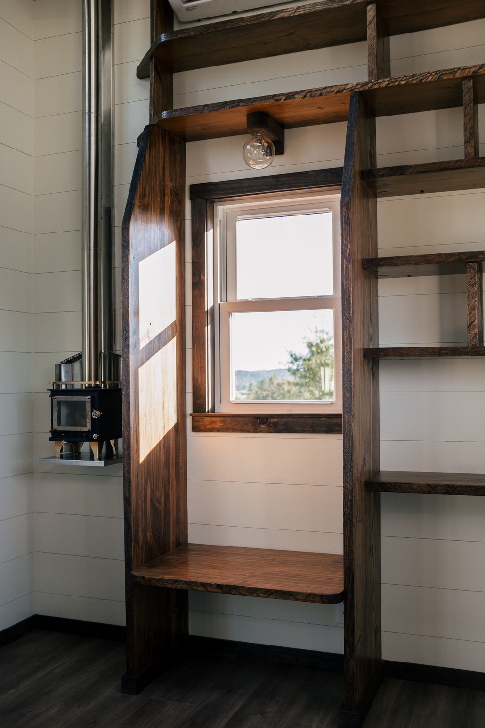 The Silhouette by Wind River Tiny Homes - ship lap, LED edison bulb light fixture, Cubic Mini wood stove