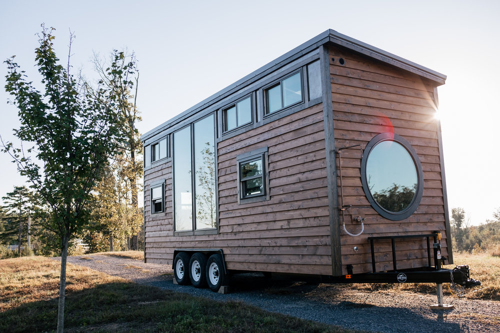 The Silhouette by Wind River Tiny Homes - rustic, cedar siding, patina steel clad siding