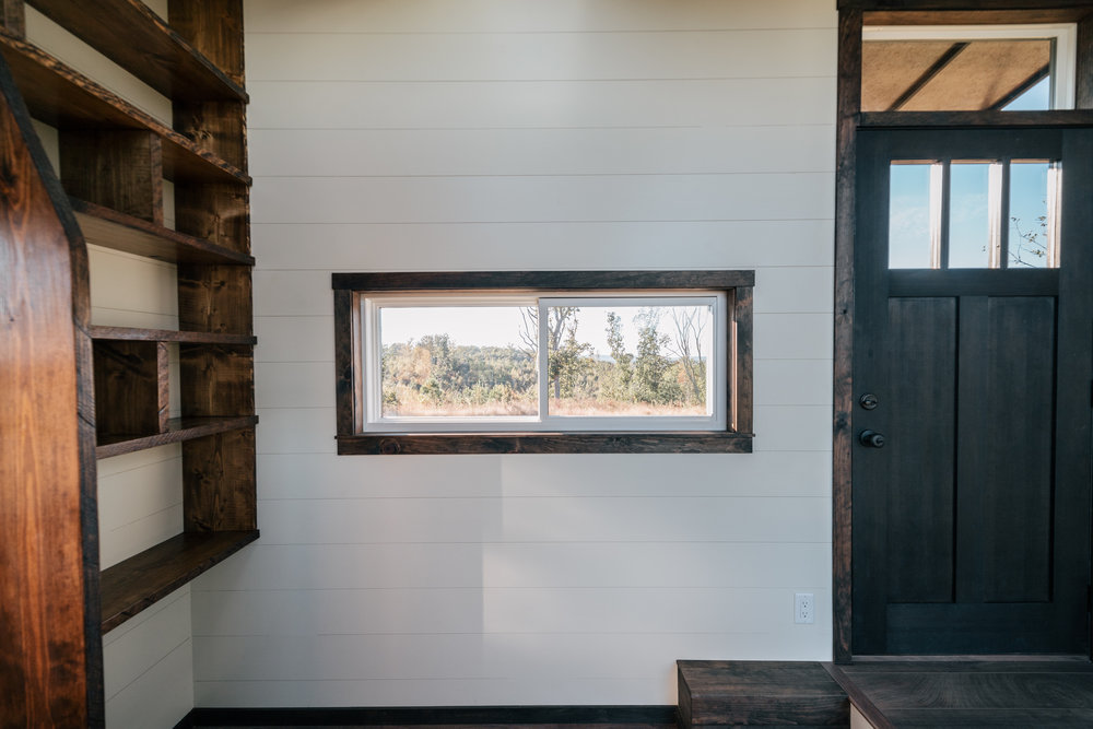 The Silhouette by Wind River Tiny Homes - ship lap, storage stairs, shaker style solid wood door
