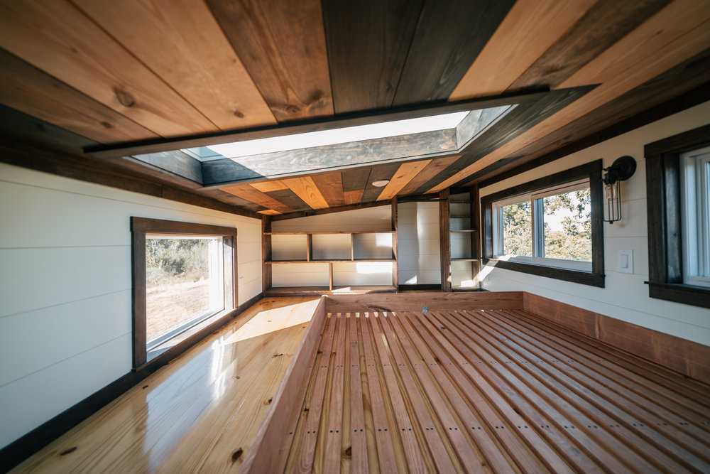 The Silhouette by Wind River Tiny Homes - ship lap, storage stairs, skylight, queen size bed frame