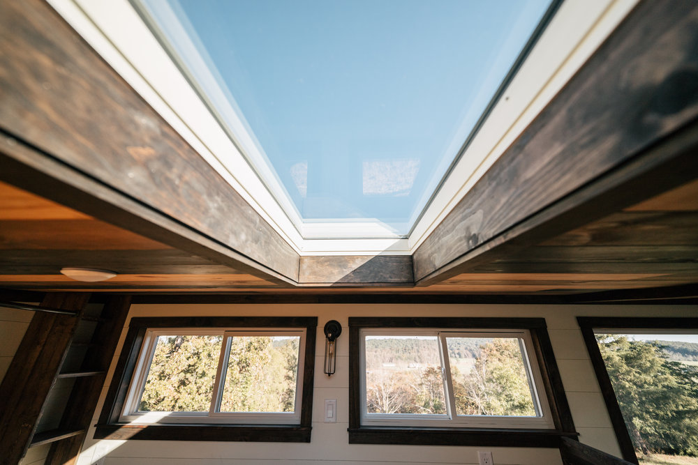 The Silhouette by Wind River Tiny Homes - ship lap, storage stairs, skylight, queen size bed frame, LED edison bulb light fixture