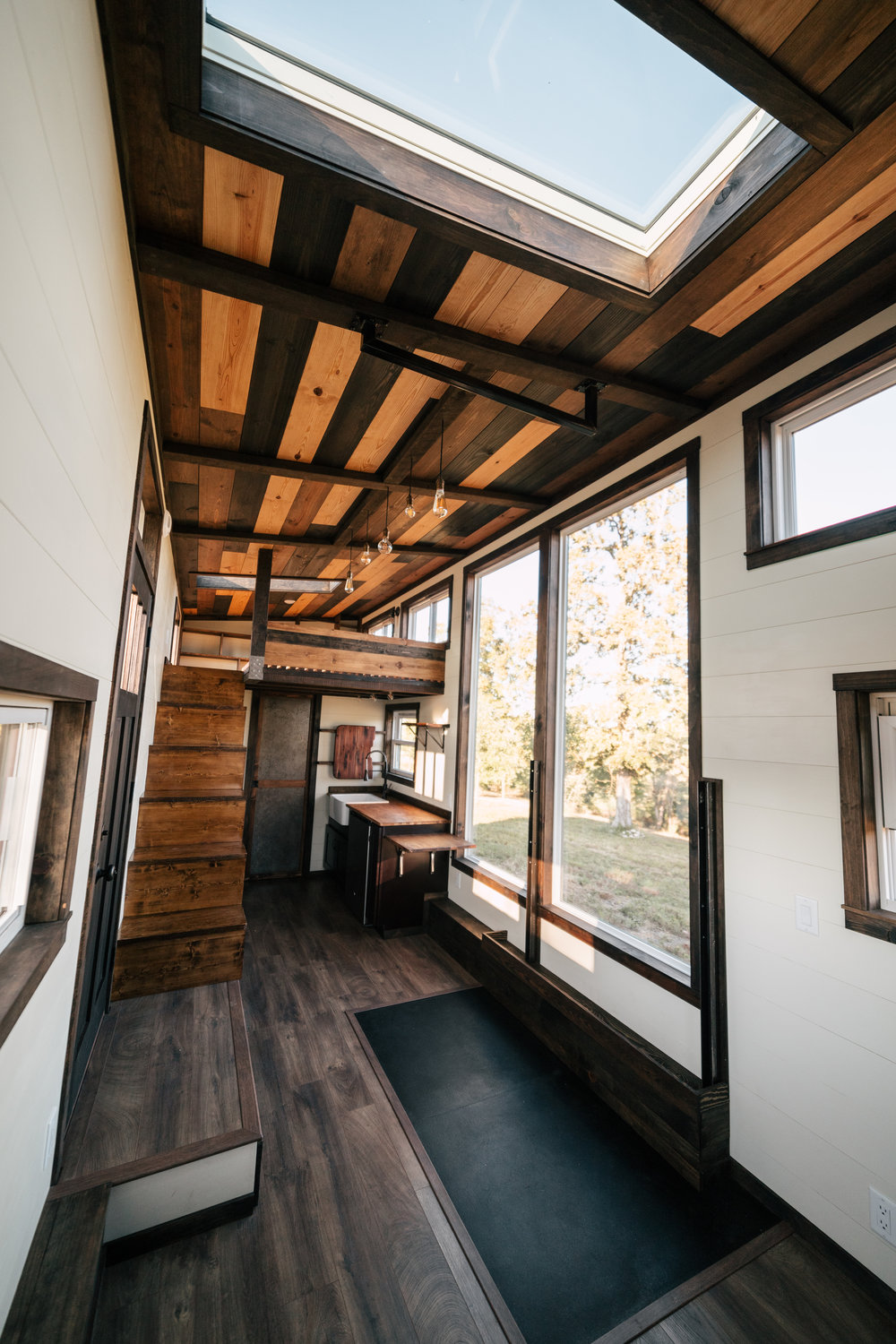 The Silhouette by Wind River Tiny Homes - ship lap, skylight, storage stairs, integrated exercise floor, LED edison bulb light fixture