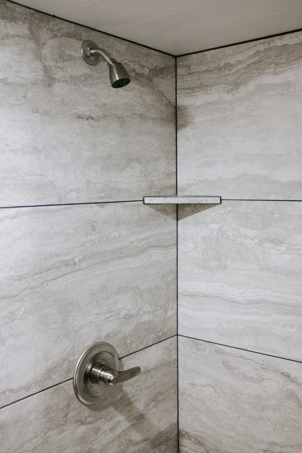 The Noah by Wind River Tiny Homes - tile shower, brushed nickel shower trim