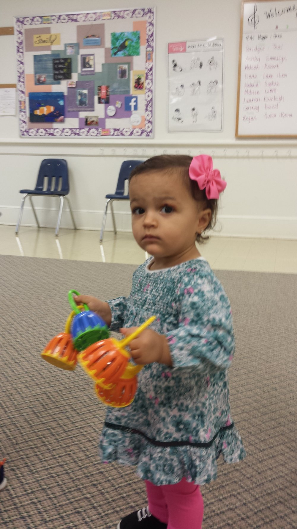 Sofia Martinez, a one year old student, is enjoying Kindermusik@school with Mrs. Gina.