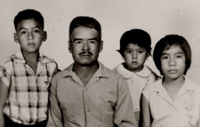 Nine-year-old Juan Palma with his father epifanio and sisters Maria Elena and aida