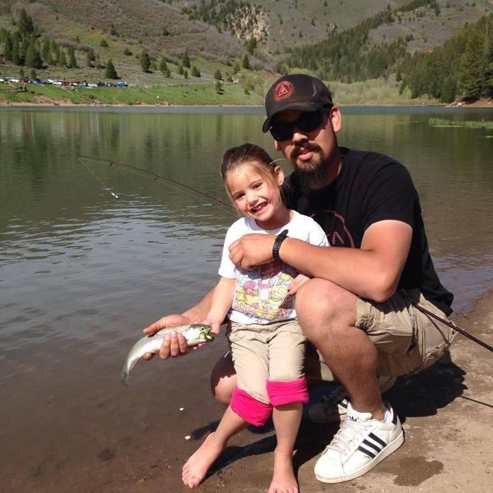 Joe Palma and Lolah fishing on Tibble Fork Lake Uinta Forest.