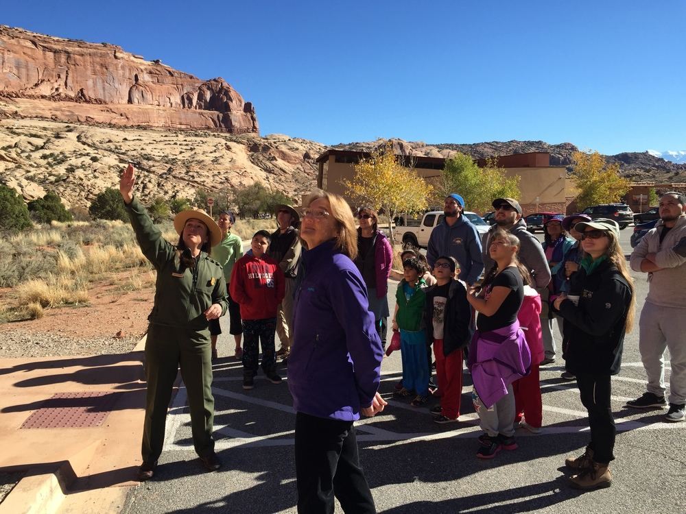 Learning about geology of arches national park from a park service ranger.