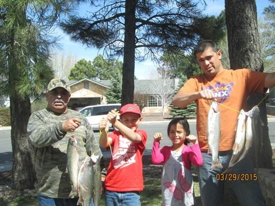 Lupe (left), grandkids Angelo and Naomi, and son Angel (right)