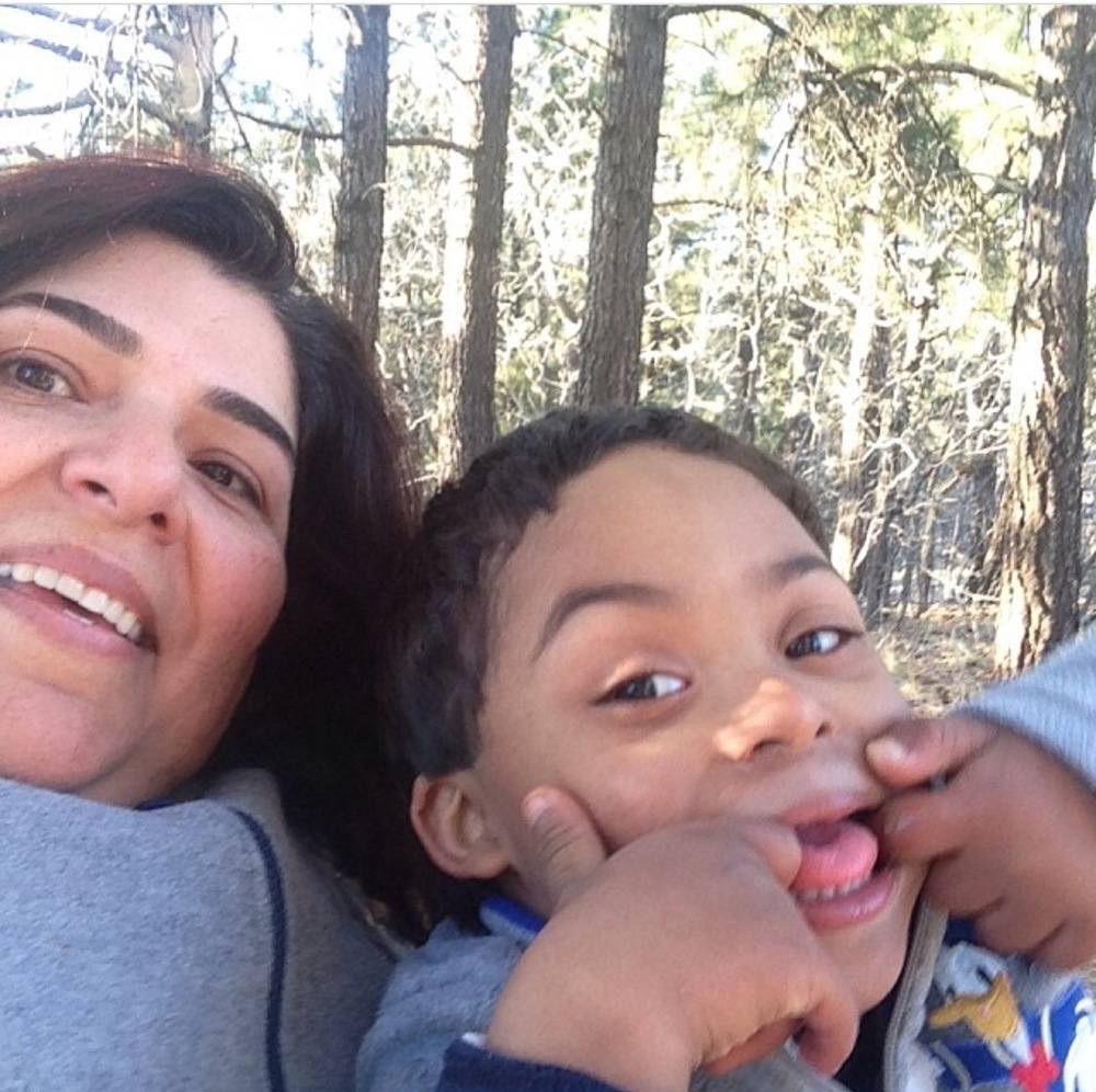 Liz and her son Demetrius talking a walk in the forest.