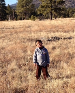 Liz's son Demetrius on a hike in the forest