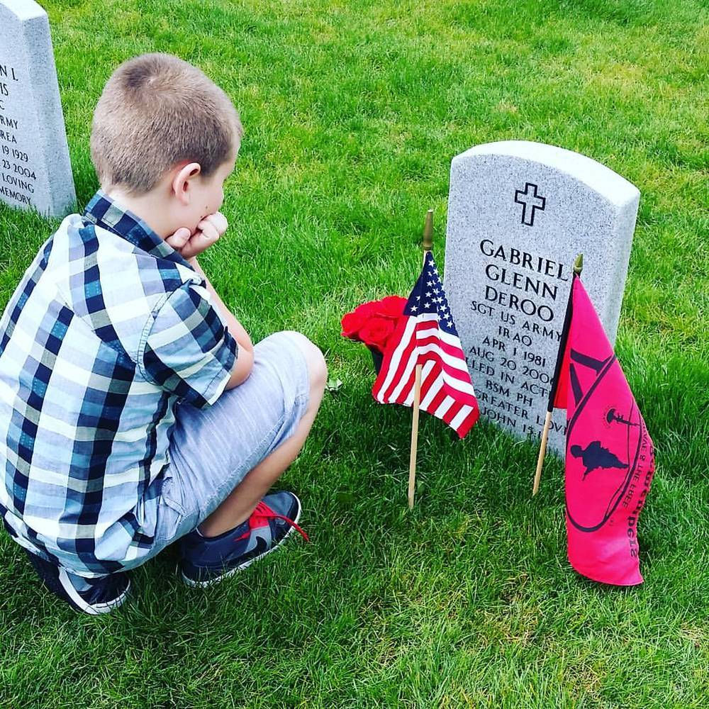 Our grandson Gabriel at his father's gravesite on Memorial Day.