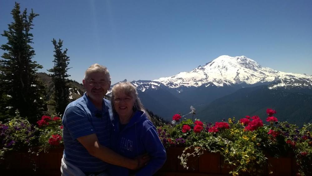 I have to admit, not many years ago 47 years sounded like a long time to be married.  Last week as we celebrated that milestone in our marriage we were blessed to travel to Crystal Mountain and enjoy lunch at the highest restaurant in Washington state (7000 feet) with an amazing view of Mt. Rainier.  What a great place to take in the beauty of God's overwhelming creation.  The view from the point pictured here was spectacular a full 360 degrees.  The God who spoke all of these mountains, trees, rivers, wildlife, and flowers into existence is also the One who has caused 47 years to seem but a short time for us.  He has blessed us with harmony, peace, and joy--and that makes time fly.  This isn't to say that there haven't been difficult times, but, God has always been with us through those times and given us stability, sacrificial love for each other, and a strong sense of being a team.  I'm very thankful to God for giving me a godly, loving, patient, and wise husband.  Now we are happily beginning our 48th year.