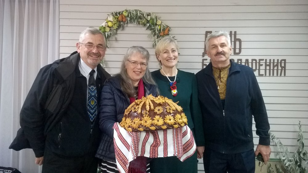 Bread, symbol of the harvest, with Nancy & I and our mission associates Maria & Velodya Sagadeyev.