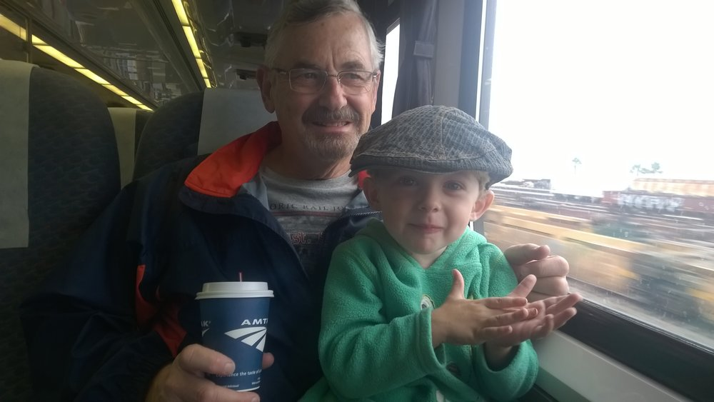 Grandpa Mark and Noah loving the train ride.