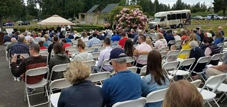 People gather at Haven of Rest Cemetery for a Memorial Day service.