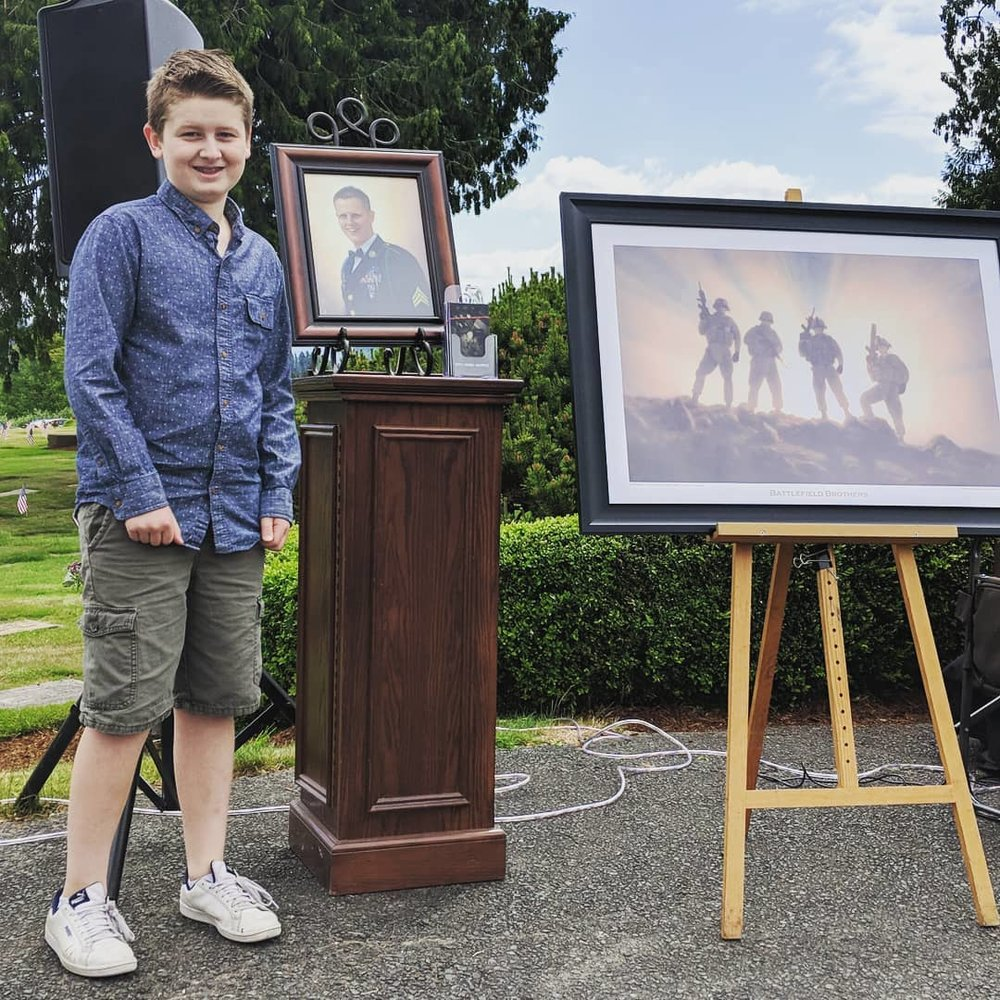 Young Gabriel show his resemblance to his father and a recent battle field painting done by his uncle Ezra.