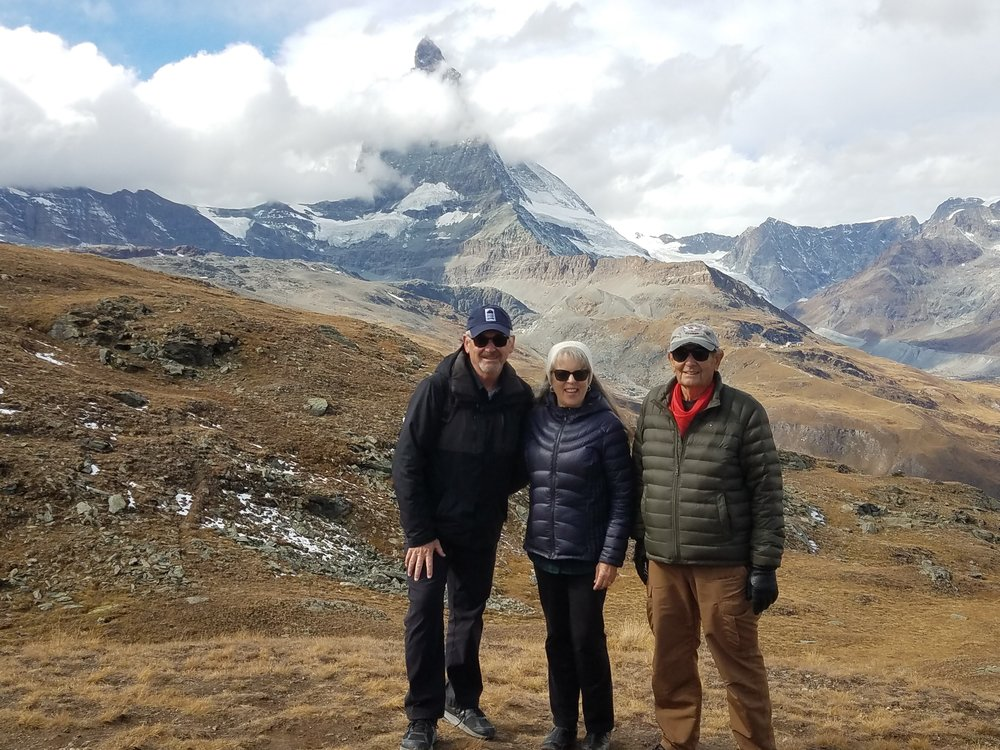 Nancy and I and my brother Gary taking a break from hiking around the Matterhorn.