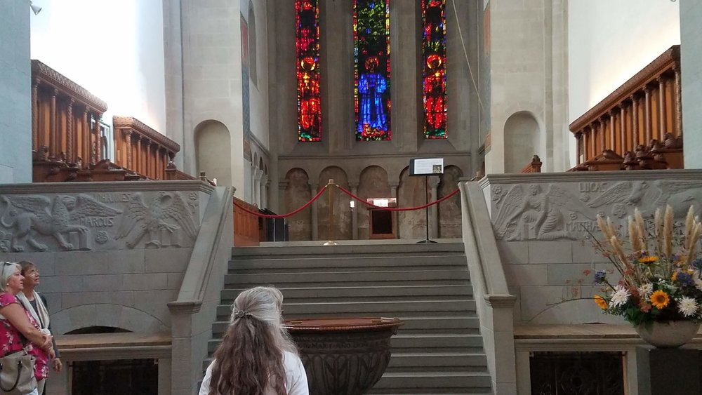 Nancy looks to where the wide pulpit once had been.