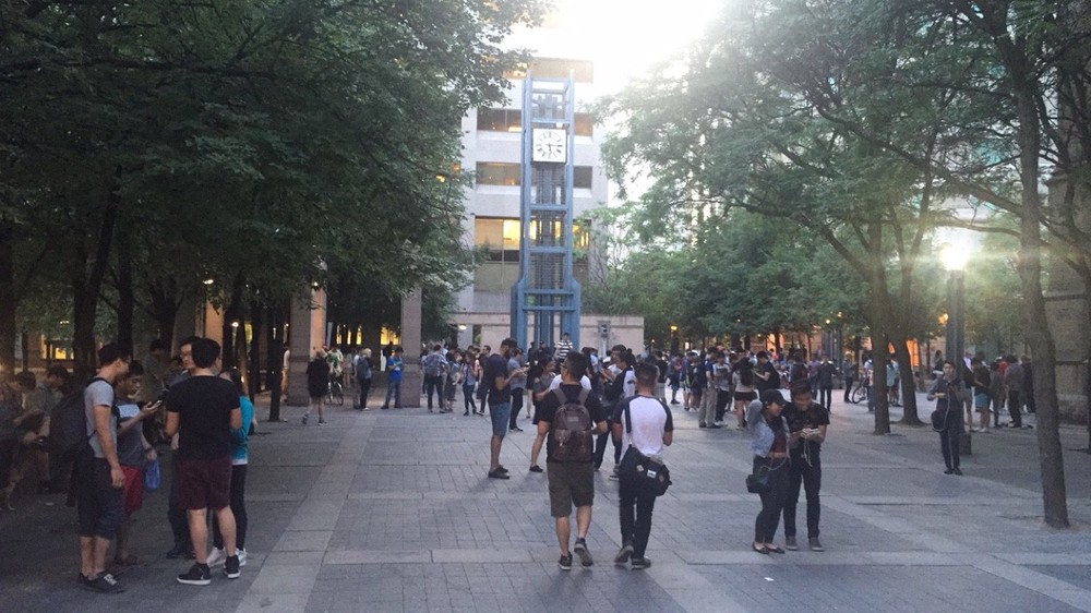 200+ people gathered outside Toronto's Eaton Centre at 9pm catching Pokemon
