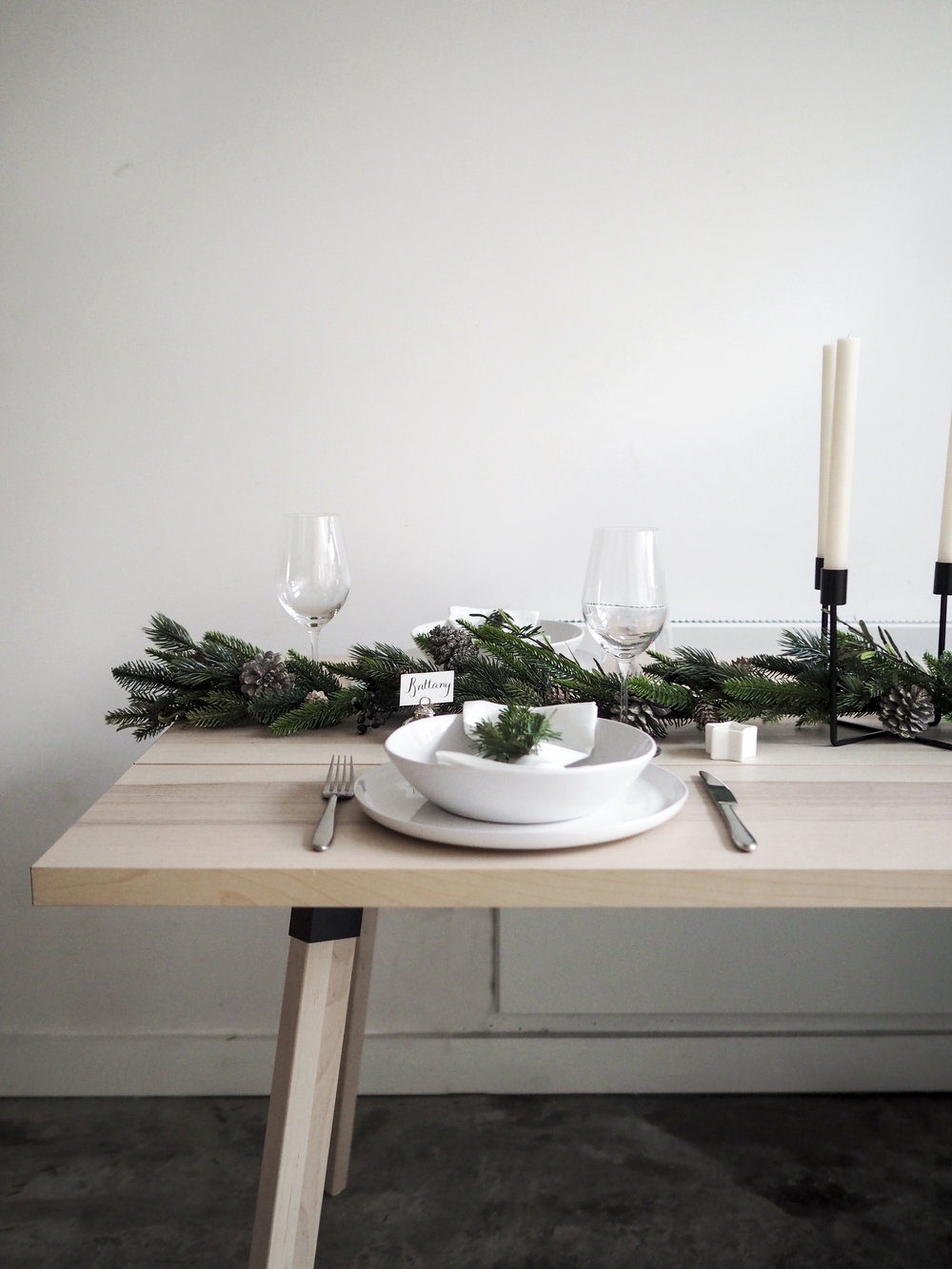 Pine Cone Garland  /  Artisan Stoneware  /  Pure Dinner Candles  /  Belgravia Wine Glasses  /  Winter Star Tealights  /  Place Card Holders